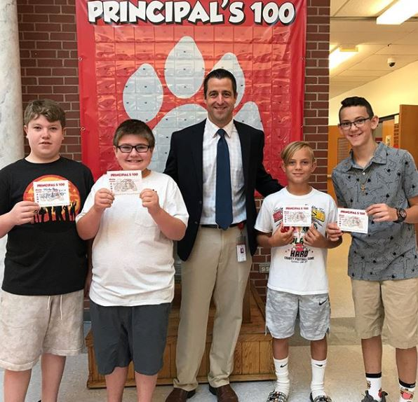 Mr. Smith awarded the first PAWS Principal's 💯 cards to five students who consistently demonstrate positive behavior at school and are role models for their peers